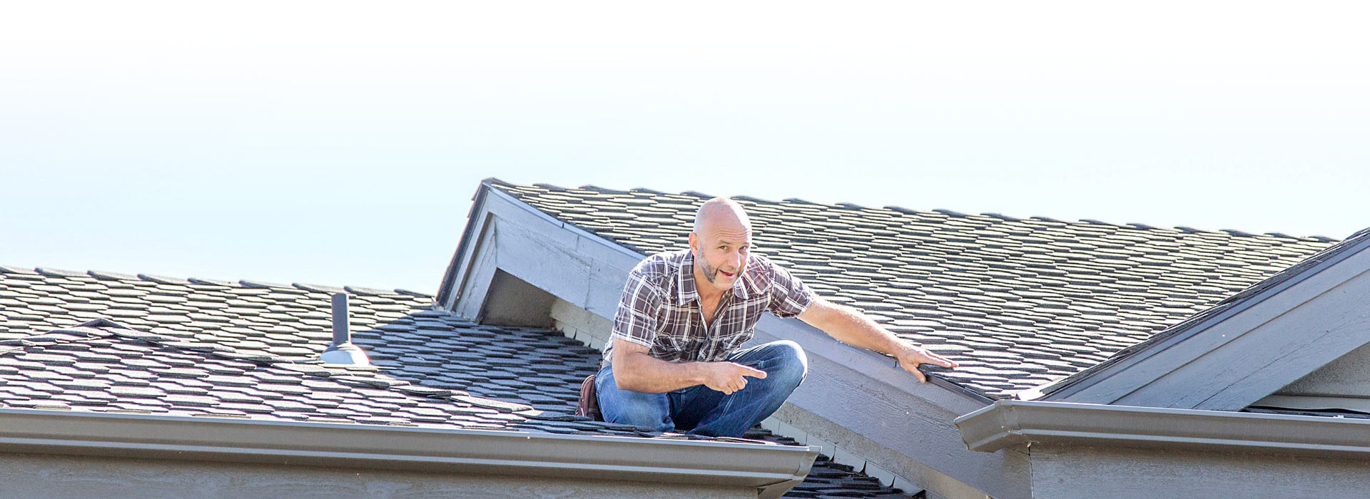 Certified Home Inspector Chris Callor performing a roof home inspection